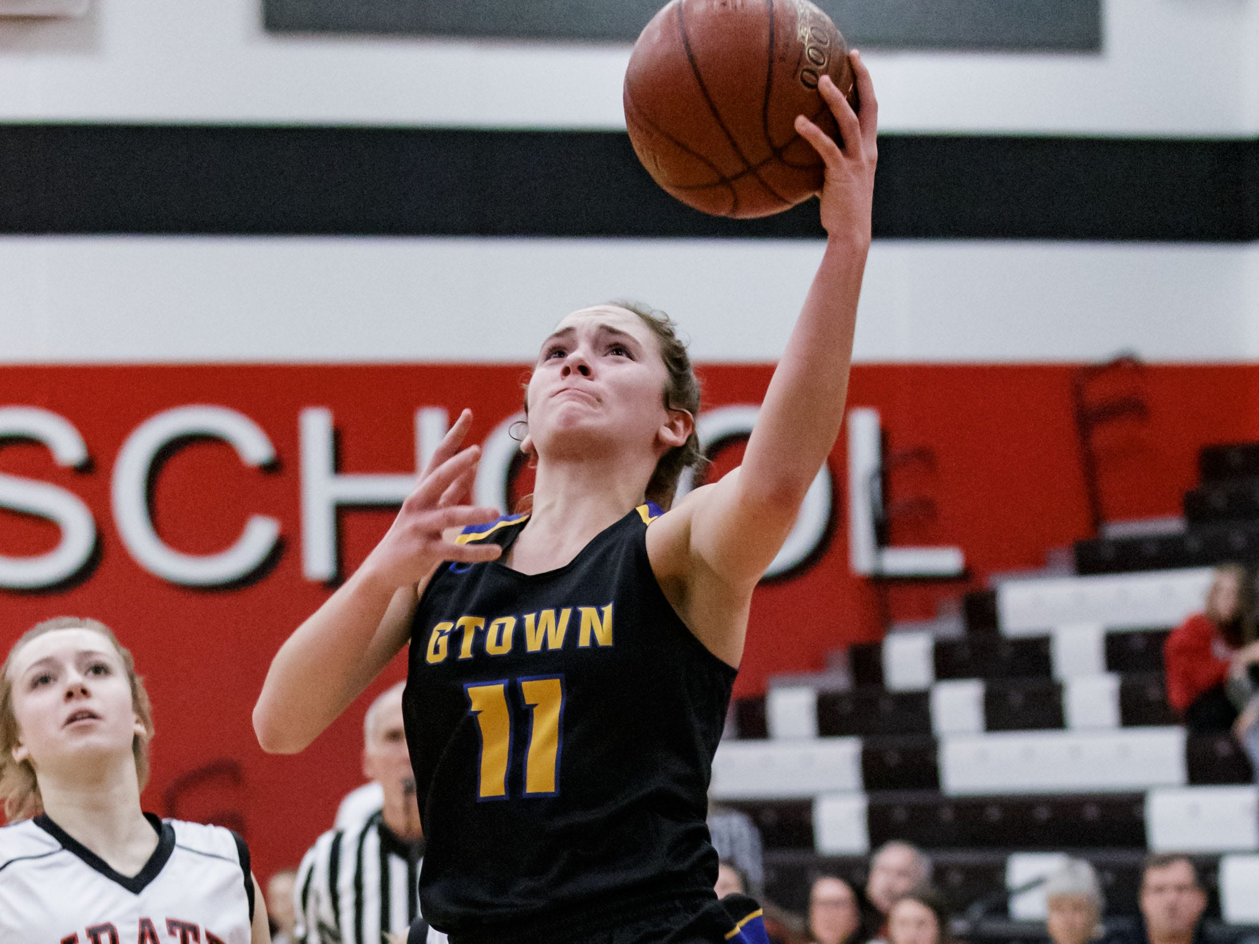 Germantown junior Natalie McNeal (11) drives in for a layup during the game at Pewaukee on Tuesday, Nov. 27, 2018.