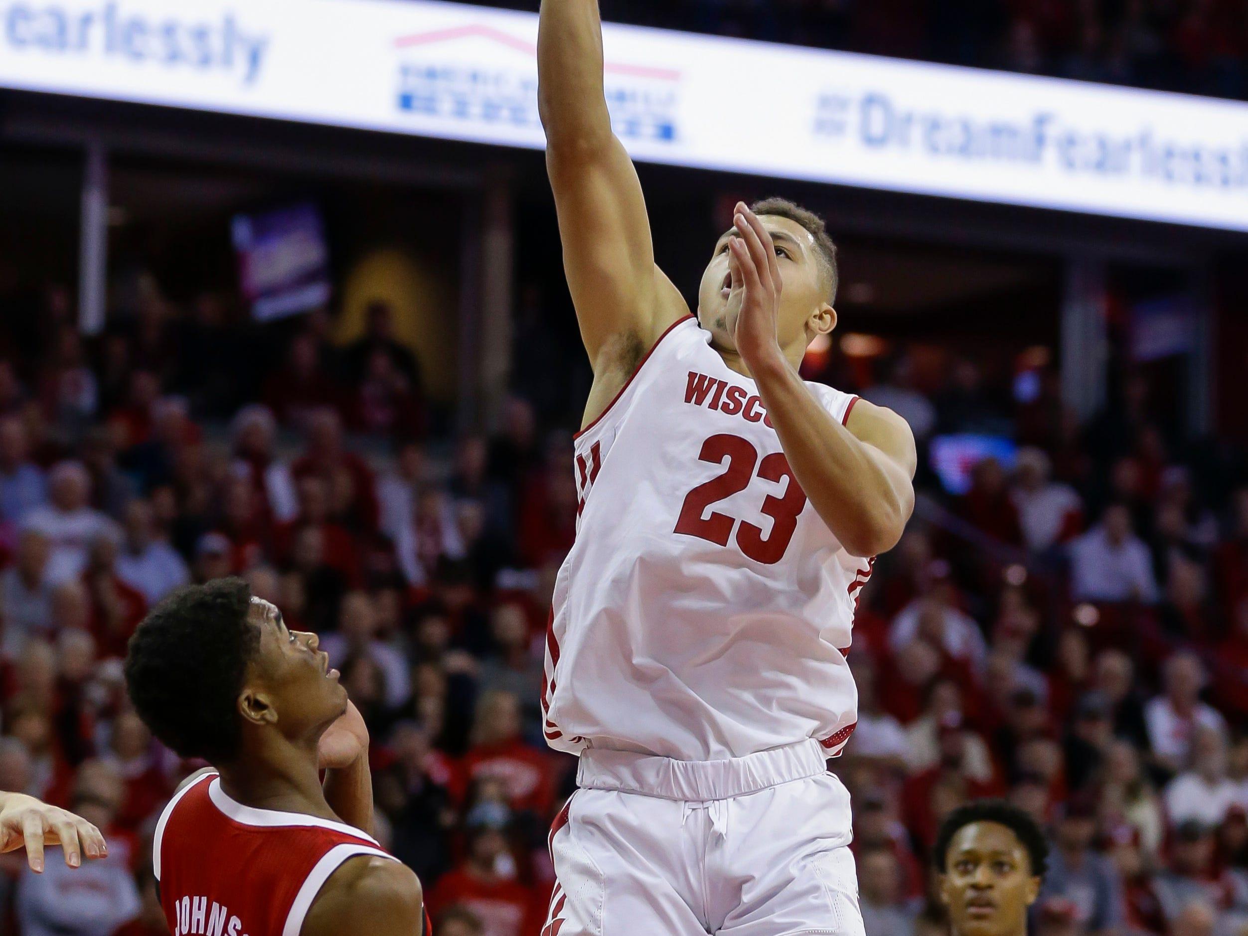Wisconsin's Kobe King shoots over North Carolina State's Markell Johnson.