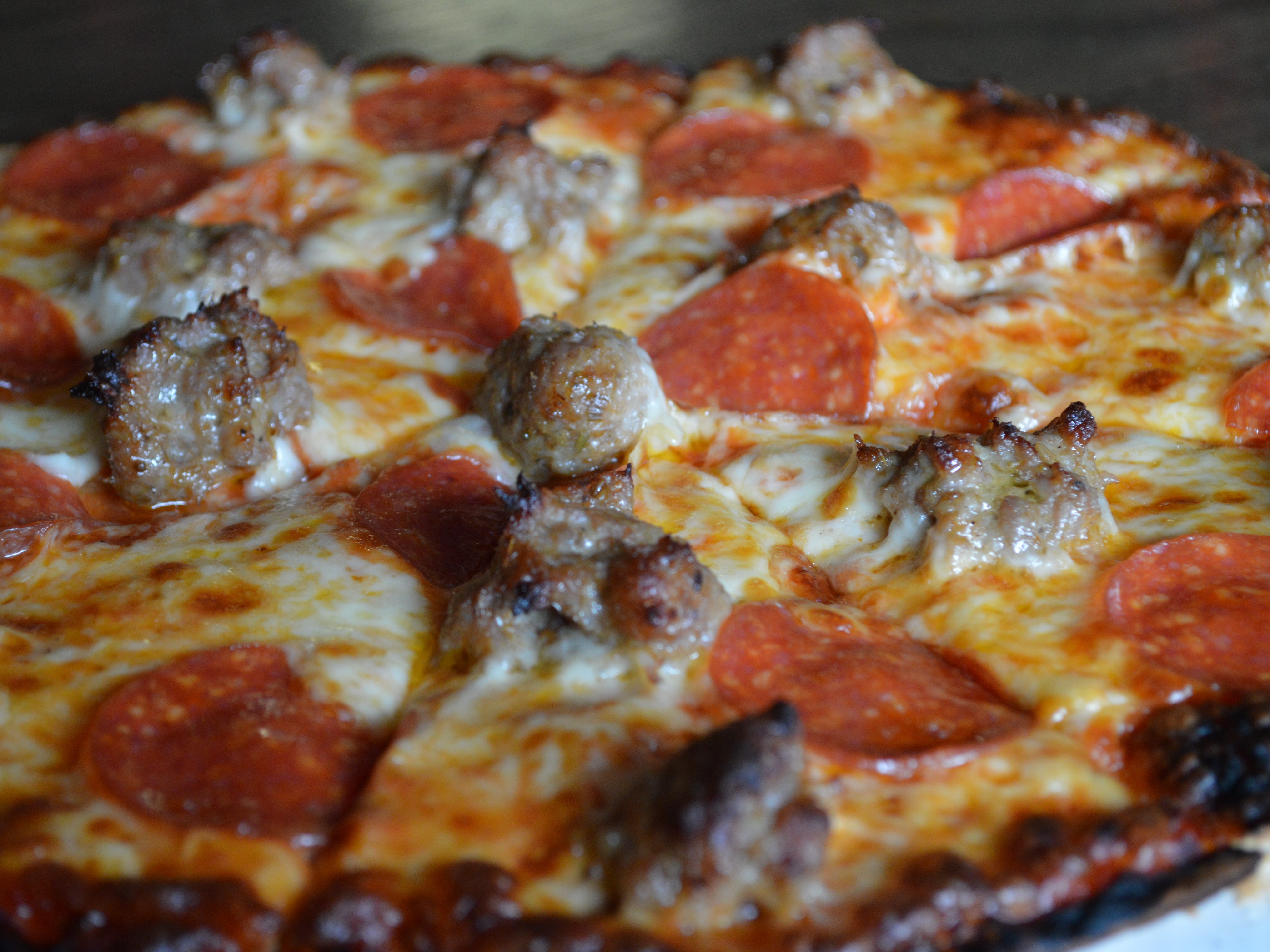 Limanski's Pub's sausage and pepperoni pizza has a homemade thin crust with San Marzano tomato sauce, mozzerella cheese, pepperoni and sausage. It costs $12 for a 12-inch.
