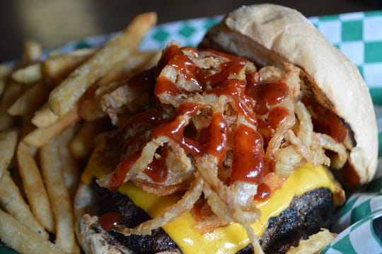 The barbecue blues burger, which was nicknamed this by a customer,has a half pound burger, bacon, cheddar cheese, haystack onion rings and barbecue sauce. It costs $11.