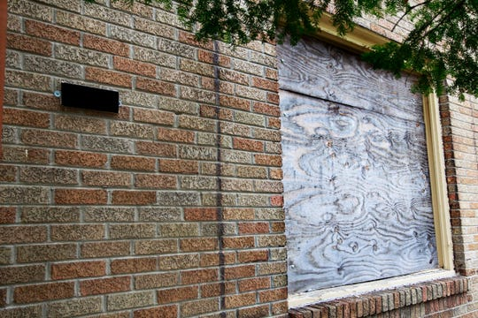 A first floor window at the home of John Wesley's father's house was broken by those trying to take illegal possession of the house. ADDRESS HAS BEEN NOTED OUT FOR PRIVACY PURPOSES.