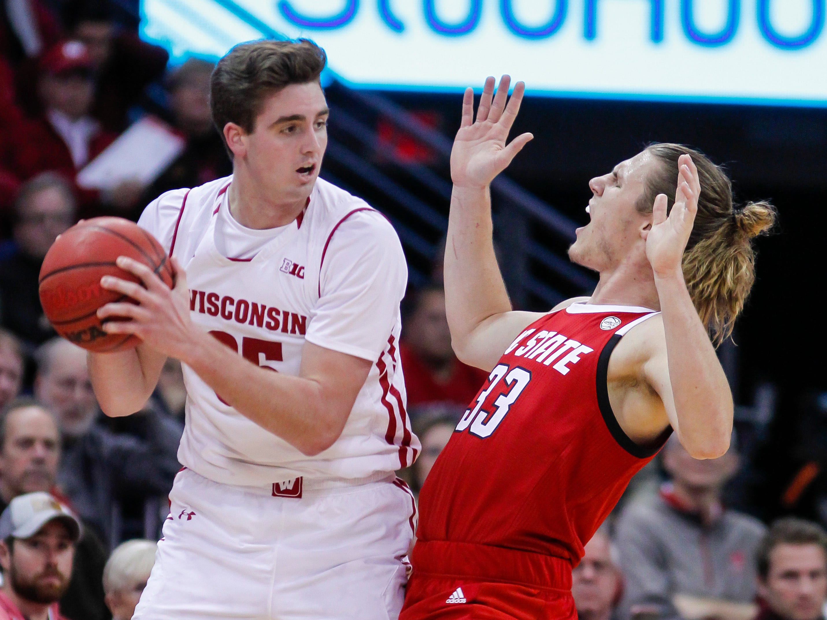 Wisconsin's Nate Reuvers is defended by North Carolina State's Wyatt Walker.