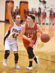 Norfork's Kinley Stowers (14) is guarded by Calico Rock's Jaycie Pool (42) on Tuesday night.