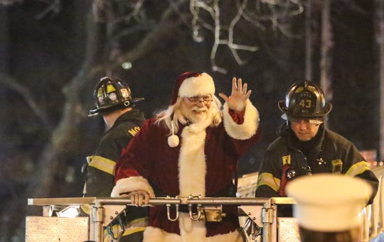 Santa Claus arrives by firetruck in Morristown in November 2016 for the annual Christmas Festival at the Morristown Green.