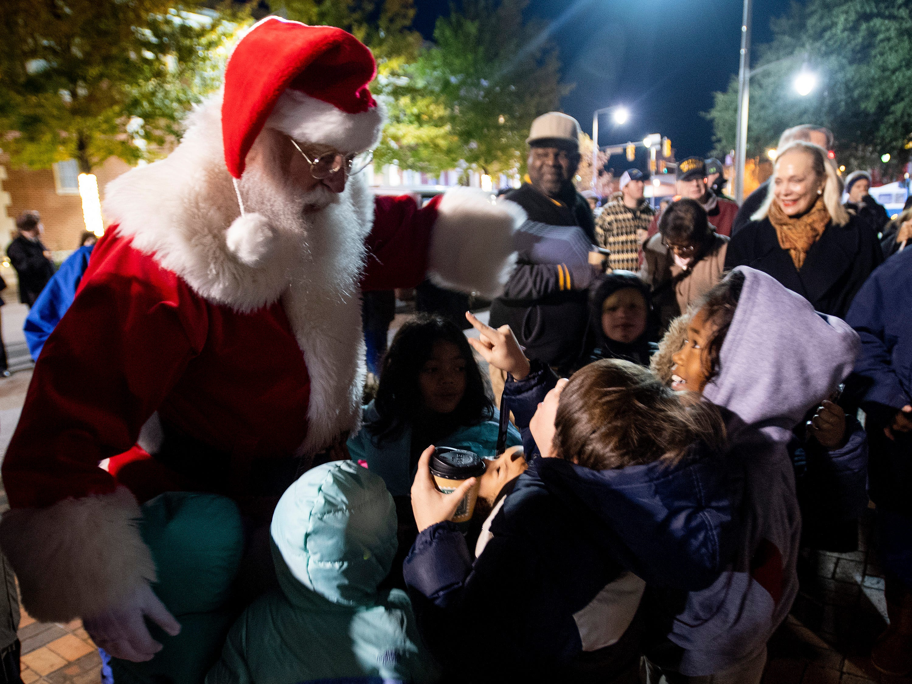 Santa Claus greets children attending the City of Montgomery Christmas Tree lighting in Montgomery, Ala., on Tuesday evening November 27, 2018.
