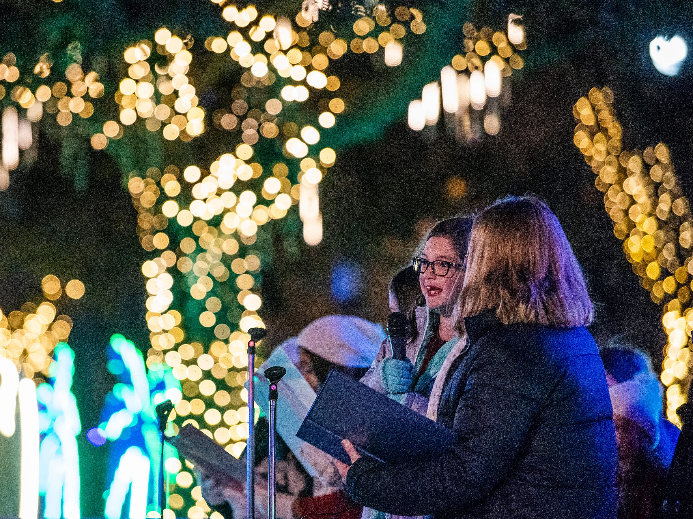 Singers from the The Vela Studio perform during the City of Montgomery Christmas Tree lighting in Montgomery, Ala., on Tuesday evening November 27, 2018.