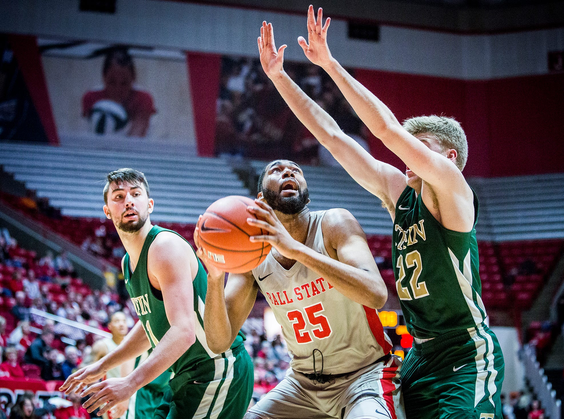 Ball State's Tahjai Teague looks to shoot past Tiffin's defense during their game at Worthen Arena Tuesday, Nov. 27, 2018.