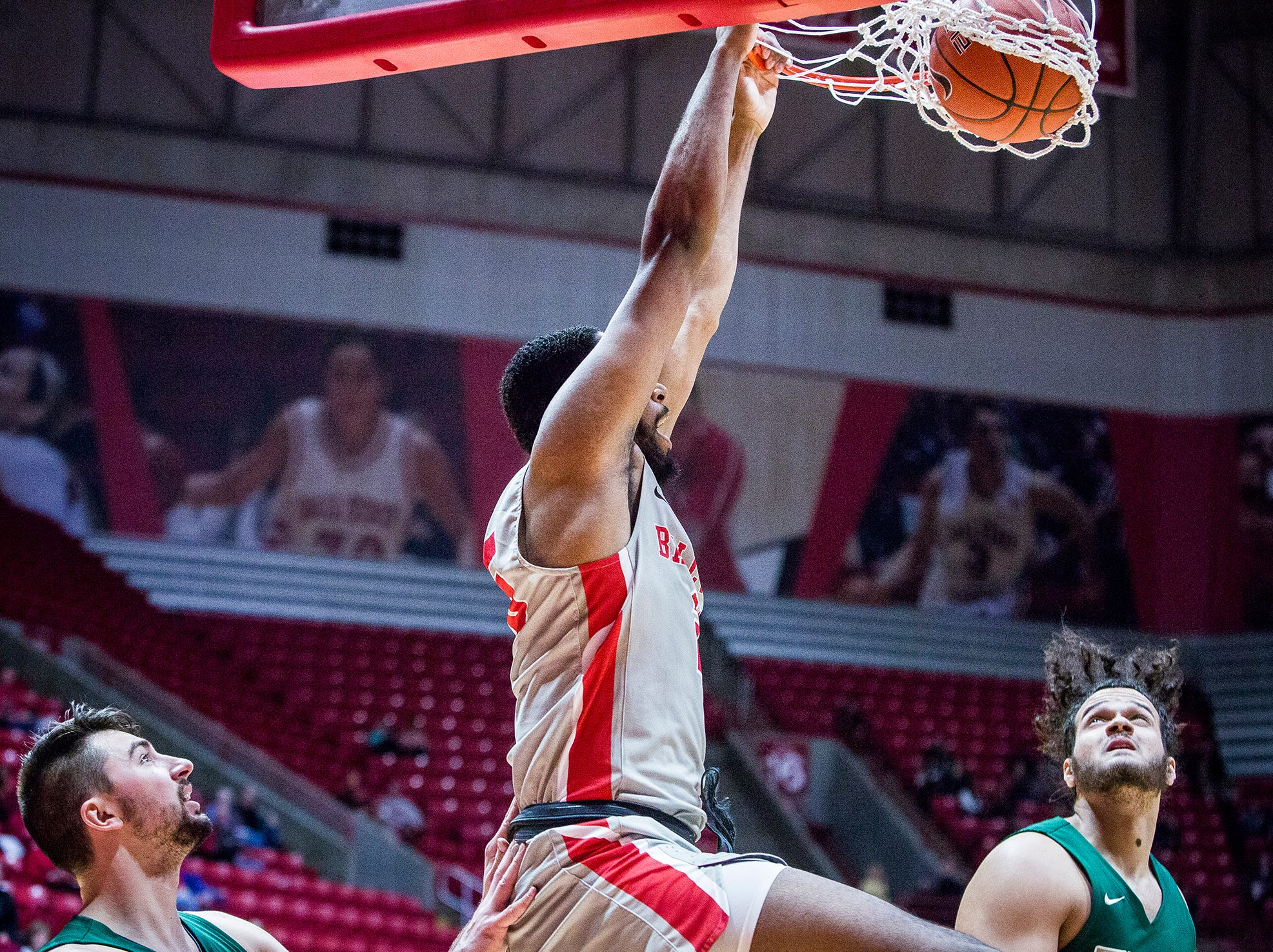 Ball State's Tahjai Teague dunks past Tiffin's defense during their game at Worthen Arena Tuesday, Nov. 27, 2018.