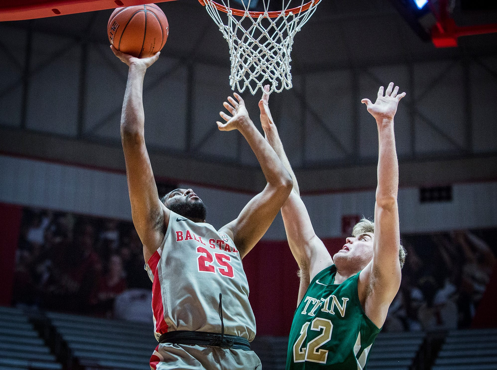 Ball State's Tahjai Teague shoots past Tiffin's defense during their game at Worthen Arena Tuesday, Nov. 27, 2018.