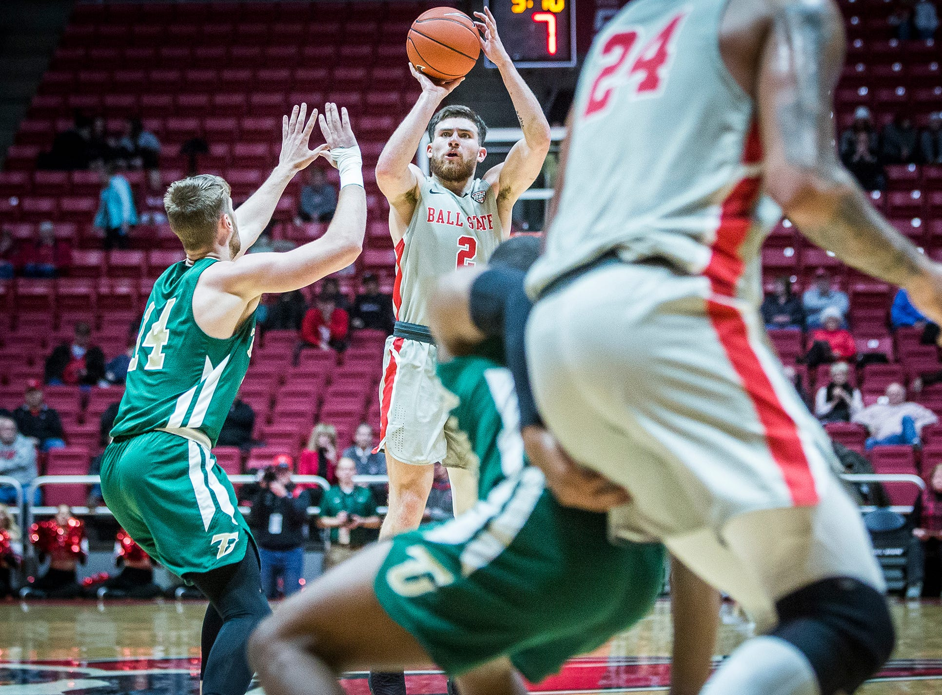 Ball State's Tayler Persons shoots past Tiffin's defense during their game at Worthen Arena Tuesday, Nov. 27, 2018.