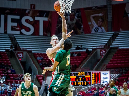 Ball State's Blake Huggins shoots past Tiffin's defense during their game at Worthen Arena Tuesday, Nov. 27, 2018.