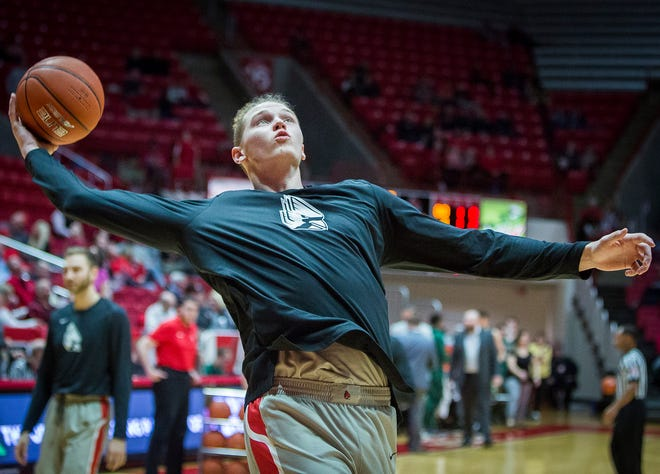 Ball State's Blake Huggins goes up for a shot during warmups against Tiffin at Worthen Arena Tuesday, Nov. 27, 2018.