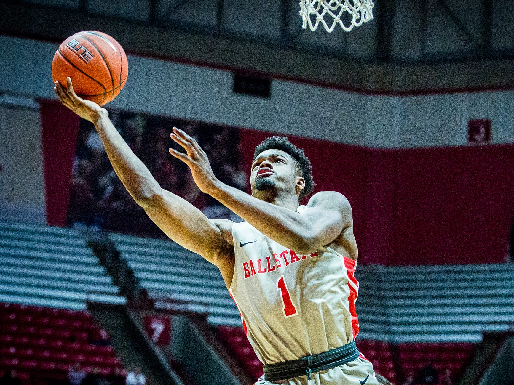Ball State's KJ Walton drives to the basket against Tiffin during their game at Worthen Arena Tuesday, Nov. 27, 2018.