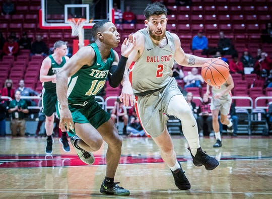Ball State's Tayler Persons fights past Tiffin's defense during their game at Worthen Arena Tuesday, Nov. 27, 2018.