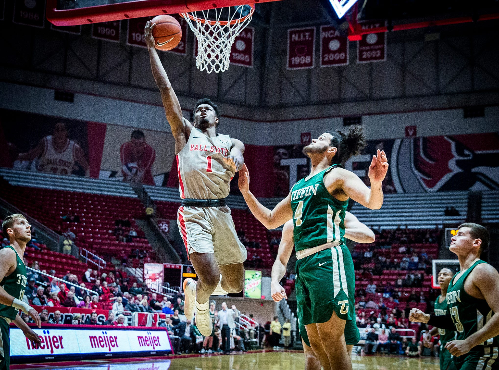 Ball State's KJ Walton shoots past Tiffin's defense during their game at Worthen Arena Tuesday, Nov. 27, 2018.