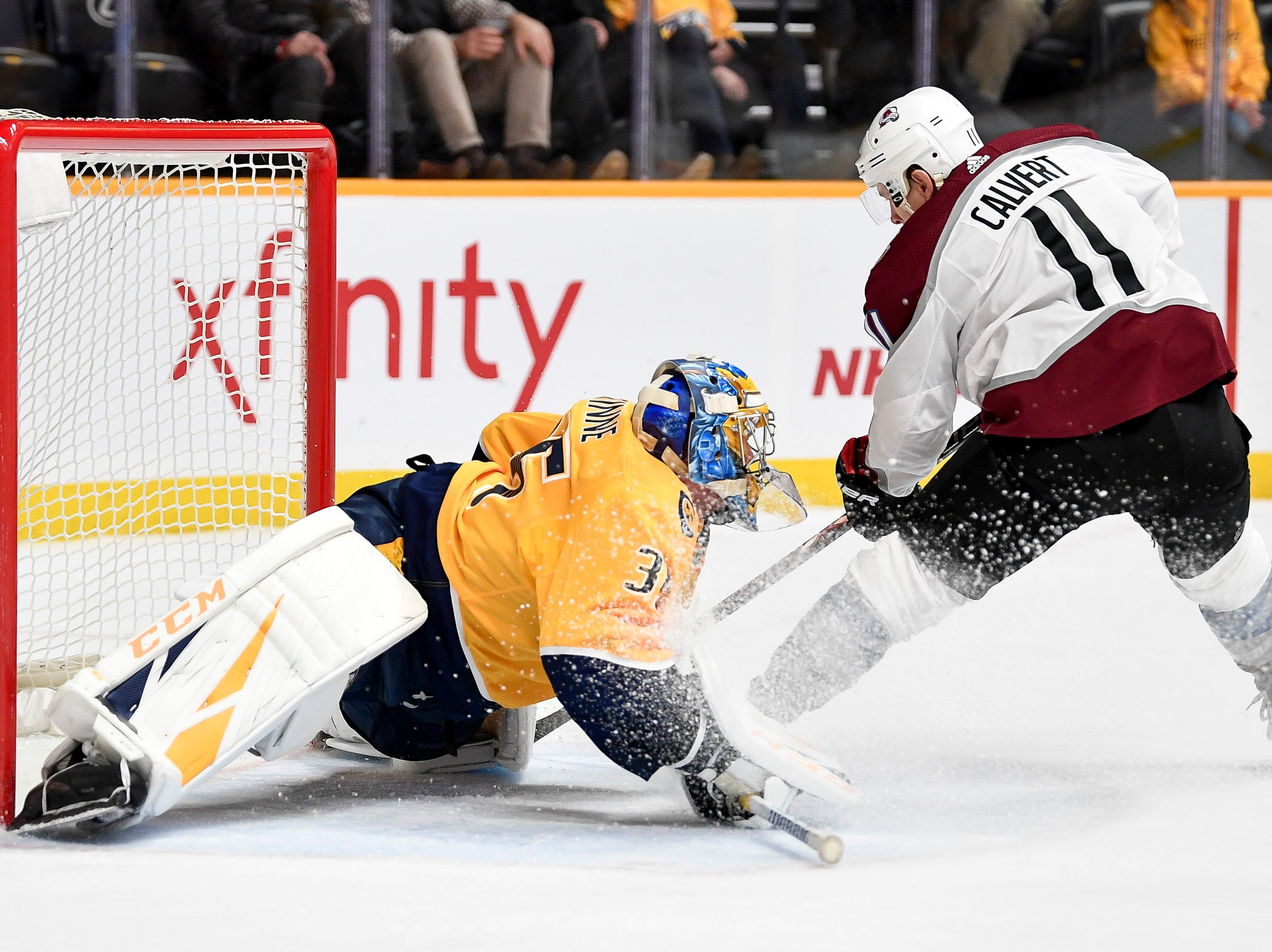 Nashville Predators goaltender Pekka Rinne (35) stops a shot from Colorado Avalanche left wing Matt Calvert (11) during the second period at Bridgestone Arena in Nashville, Tenn., Tuesday, Nov. 27, 2018.