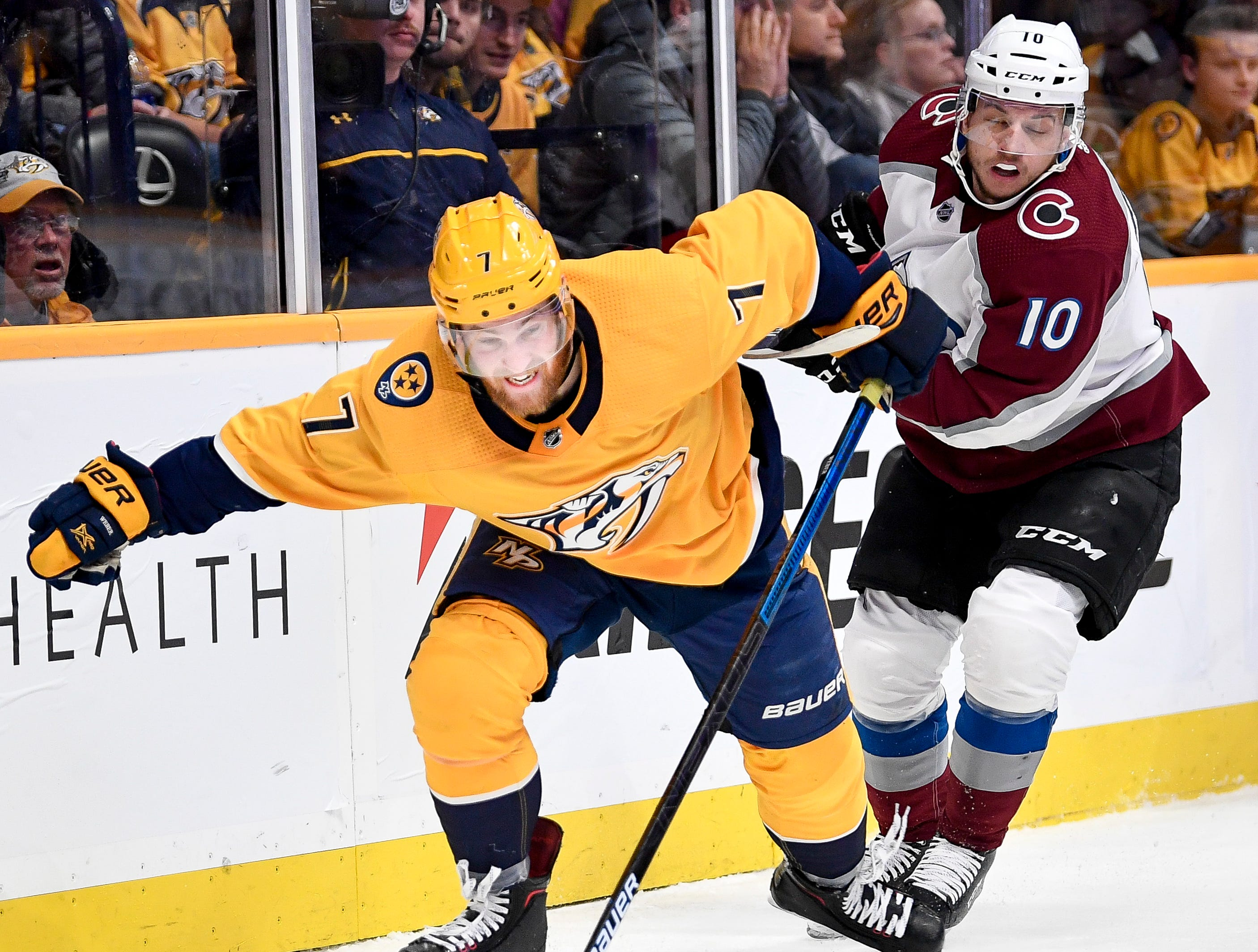 Nashville Predators defenseman Yannick Weber (7) chases the puck with Colorado Avalanche right wing Sven Andrighetto (10) during the second period at Bridgestone Arena in Nashville, Tenn., Tuesday, Nov. 27, 2018.