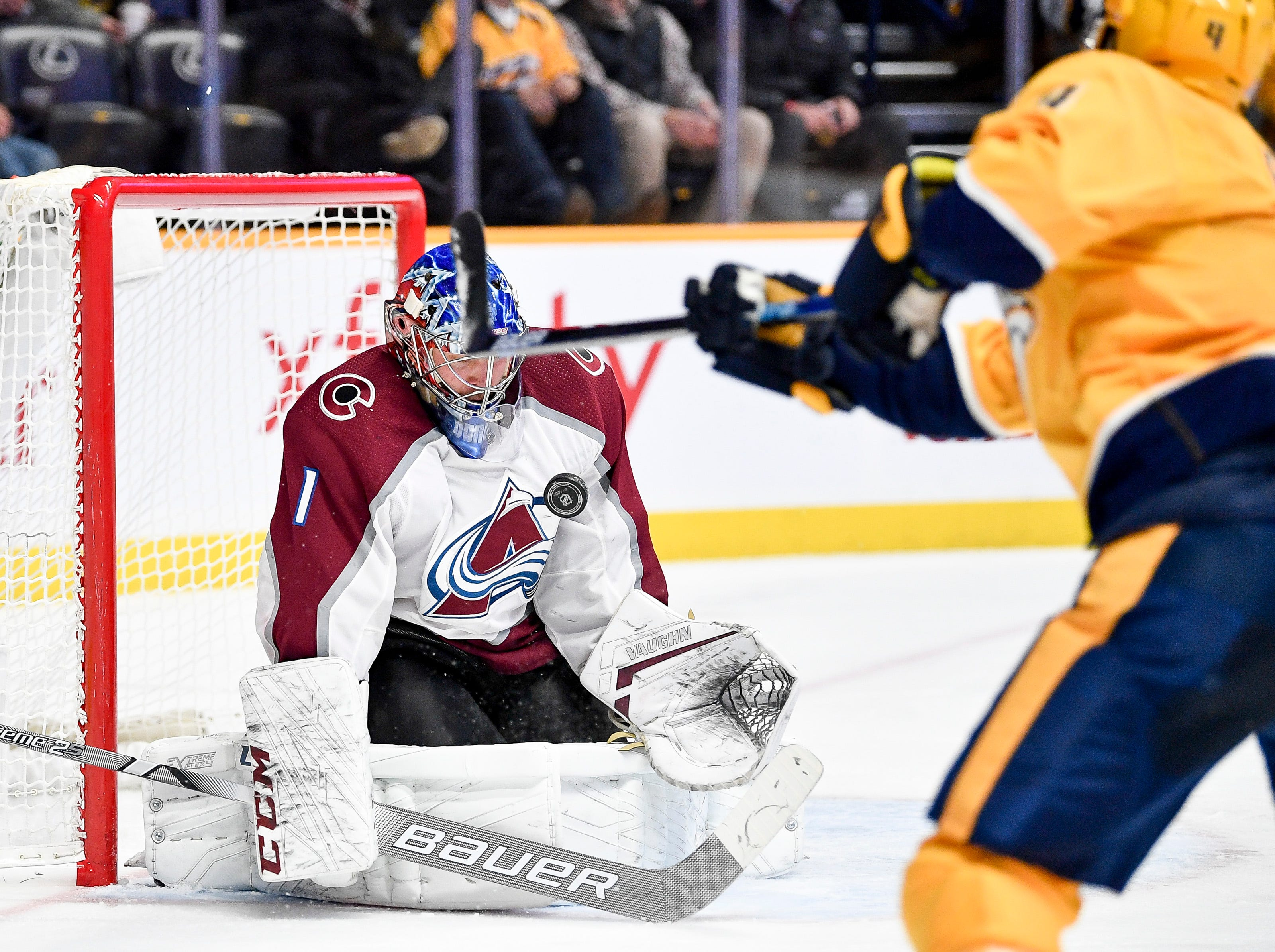 Colorado Avalanche goaltender Semyon Varlamov (1) stops a shot from Nashville Predators defenseman Ryan Ellis (4) during the third period at Bridgestone Arena in Nashville, Tenn., Tuesday, Nov. 27, 2018.