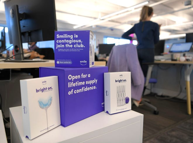 SmileDirectClub sends teeth aligners to people, helping people more easily straighten their teeth than traditional braces. Boxes are displayed throughout the company's Nashville office.