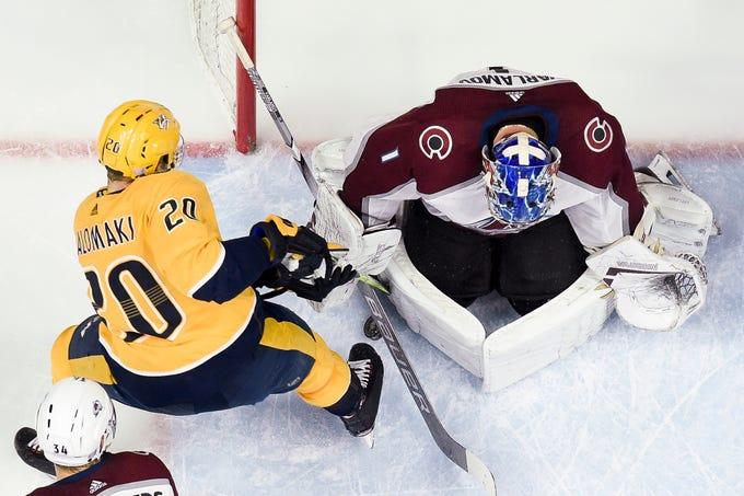 Colorado Avalanche goaltender Semyon Varlamov (1) defends against Nashville Predators right wing Miikka Salomaki (20) during the second period at Bridgestone Arena in Nashville, Tenn., Tuesday, Nov. 27, 2018.