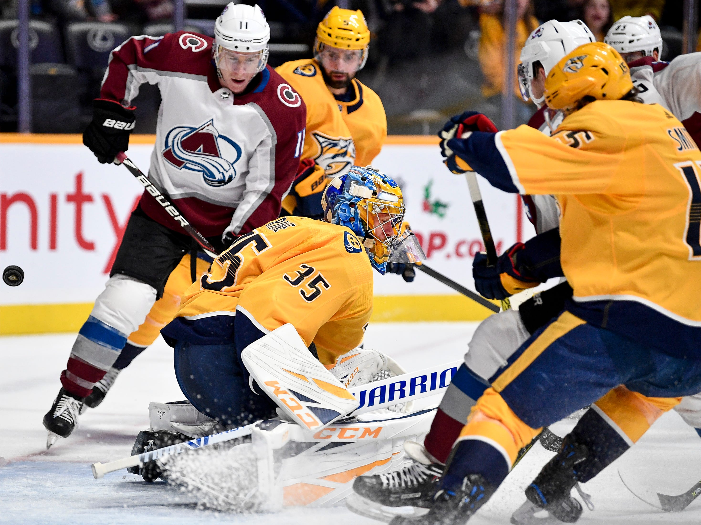 A Colorado Avalanche shot bounces off of the goal behind Nashville Predators goaltender Pekka Rinne (35) during the second period at Bridgestone Arena in Nashville, Tenn., Tuesday, Nov. 27, 2018.