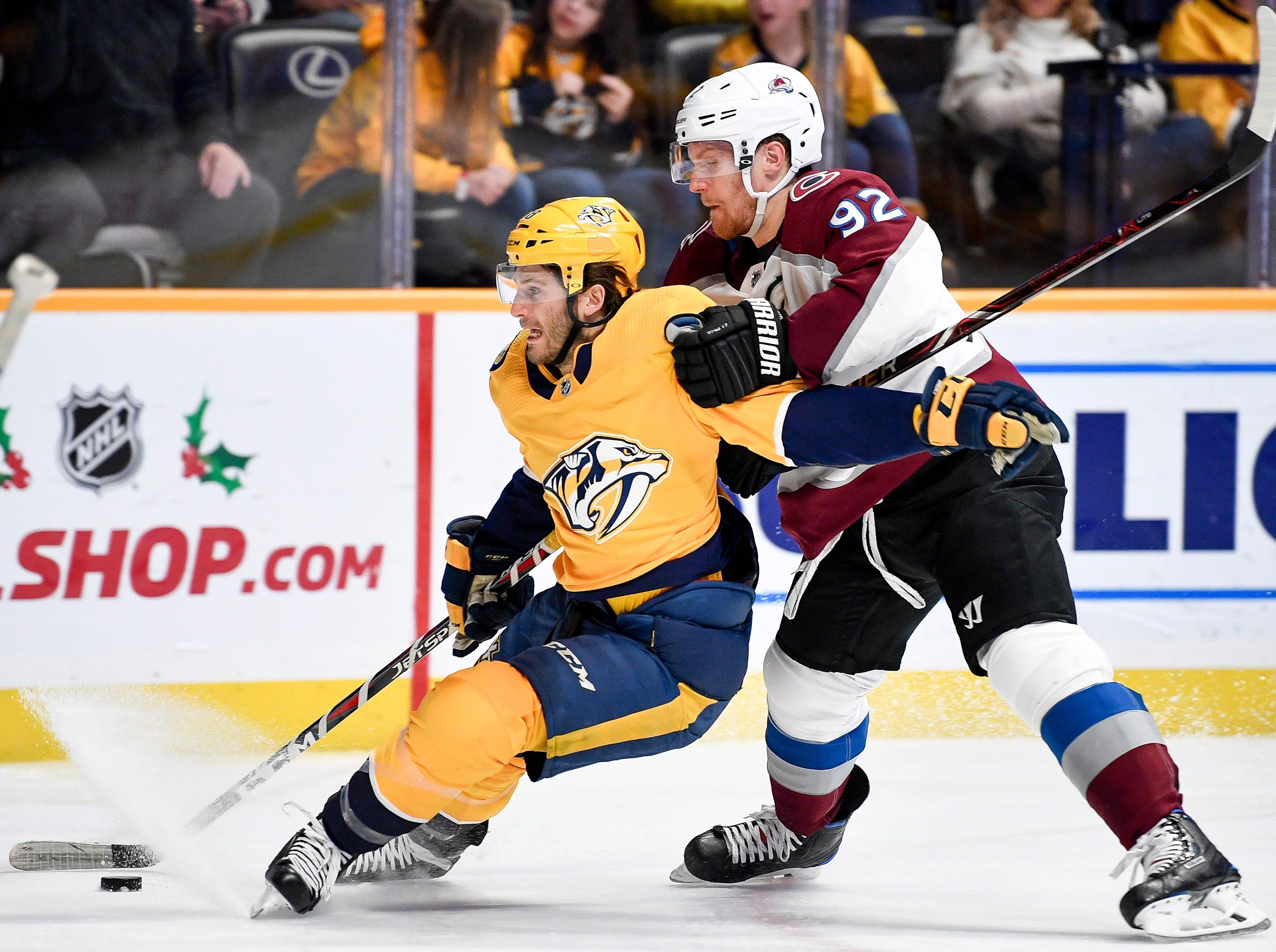 Nashville Predators right wing Ryan Hartman (38) battles Colorado Avalanche left wing Gabriel Landeskog (92) during the third period at Bridgestone Arena in Nashville, Tenn., Tuesday, Nov. 27, 2018.