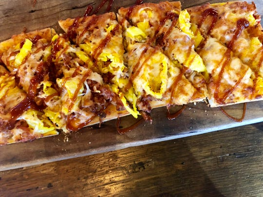 A smoked chicken and bacon flatbread drizzled with spicy barbecue glaze at  Bone Hook Brewing Co. in North Naples.