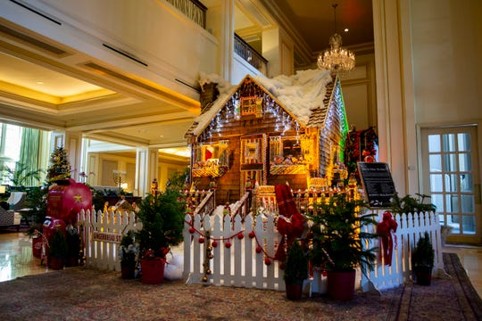"""Pastry Chef Lerome Campbell's life-size gingerbread house sits in the lobby on Wednesday, November 28, 2018, at the Ritz-Carlton in Naples. Campbell is a contestant on Food Network's """"Holiday Baking Championship,"""" which airs on Monday nights."""