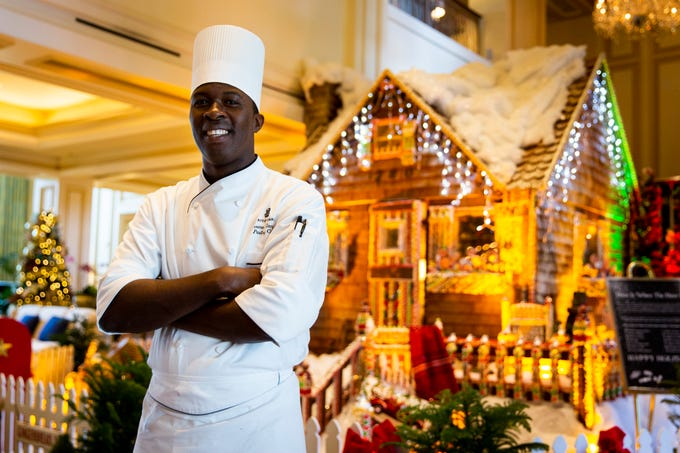 "Pastry chef Lerome Campbell stands in front of his life-size gingerbread house on Wednesday, Nov. 28, 2018, at the Ritz-Carlton beach resort in North Naples. Campbell is a contestant on Food Network's ""Holiday Baking Championship,"" which airs on Monday nights."