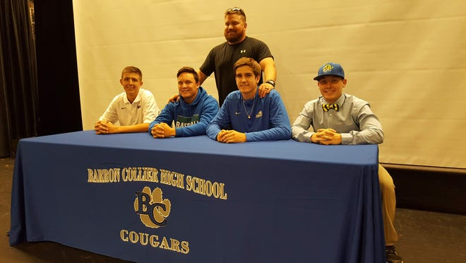 Barron Collier baseball players pose after signing letters of intent to play in college on Wednesday, Nov. 28, 2018. From left to right: Sean Means, Johnny Long, coach Charlie Maurer (back), Aidan Bennett, Dylan Doria.