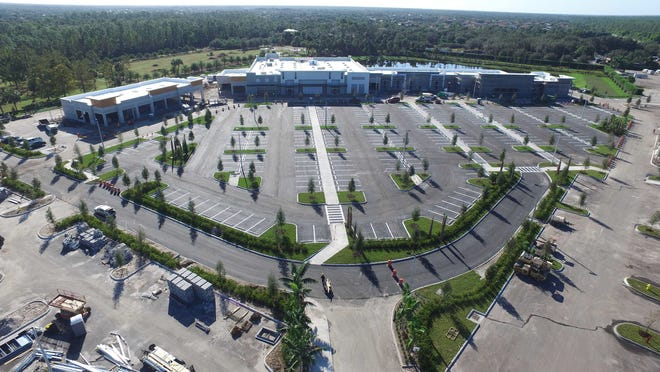 An aerial of Logan Landings retail center, anchored by Sprouts Farmers Market, center, under construction on the southeast corner of Logan Boulevard and Immokalee Road in North Naples.