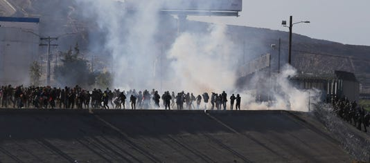 Us Mexico Crossing Closed Tear Gas Apparently Fired As Migrants Rush Toward Border