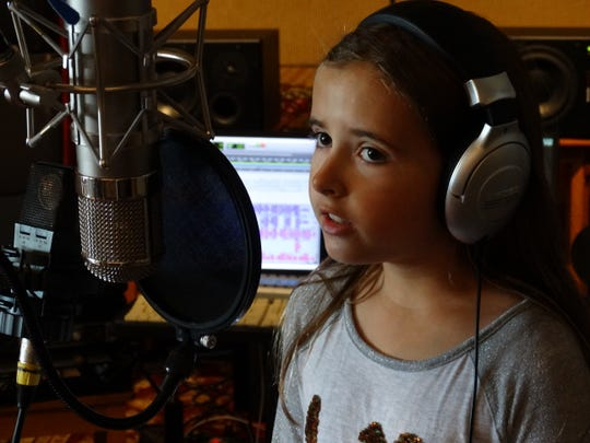 """Naples fourth grader Kylie Gust, 10, records her Christmas album """"A Kylie Christmas"""" in a Wisconsin studio this  summer. She released the album to support national charities like The Humane Society."""