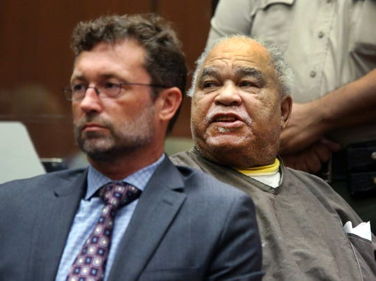 Samuel Little shouts as he is sentenced to three consecutive terms of life in prison without parole for murdering three women in the late 1980s, in a Los Angeles courtroom Thursday, Sept. 25, 2014. Little, 74, shouted out in court during his sentencing hearing that he didn't commit the killings and said he hoped for a new trial. His lawyer Michael Pentz, left, has filed a notice of appeal.