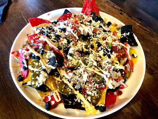 Nachos smothered in Honey Hole beer cheese with black beans, jalapenos and spicy sour cream at Bone Hook Brewing Co. in North Naples.