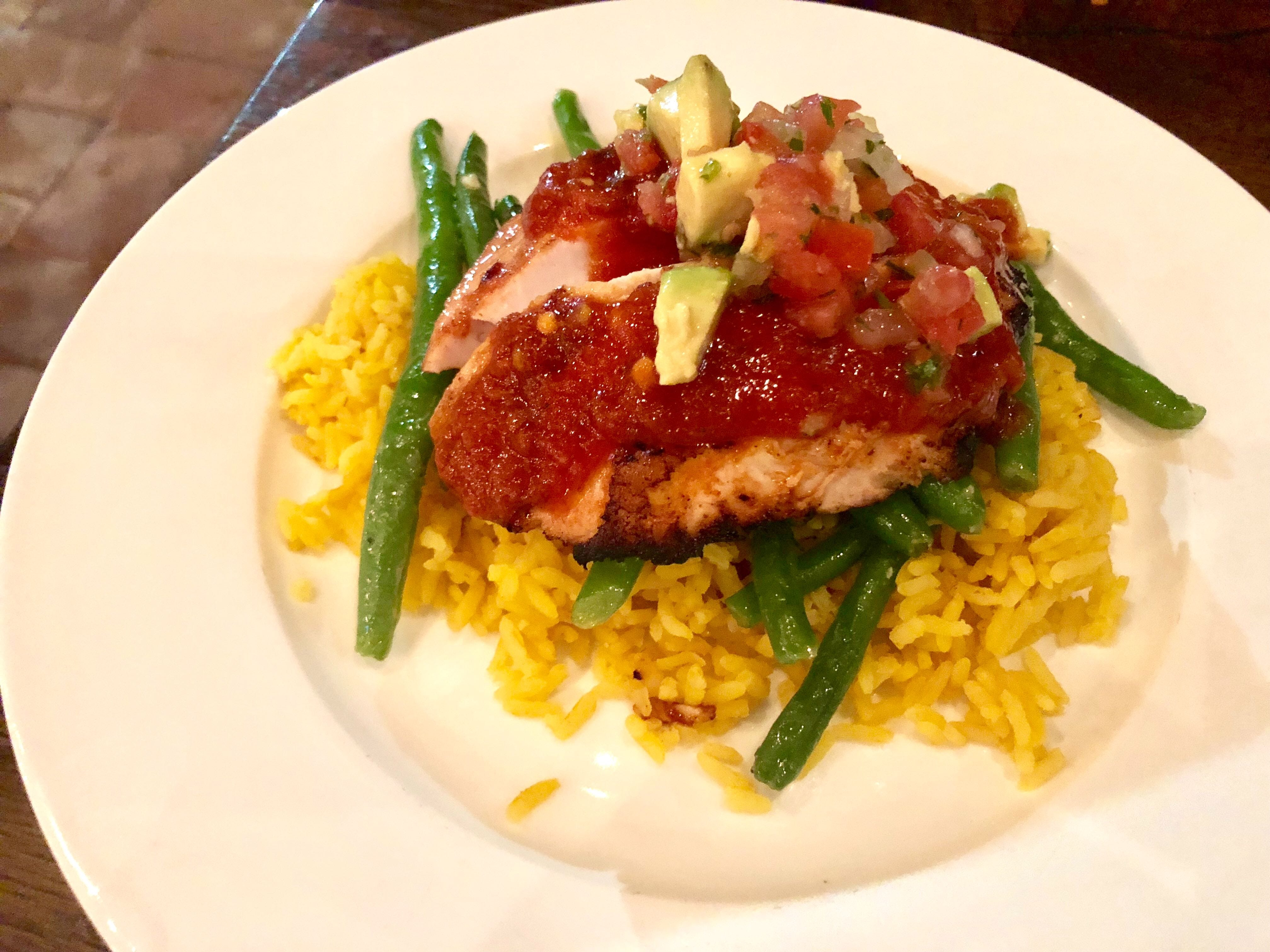 Chipotle-rubbed mahi with yellow rice and green beans at Bone Hook Brewing Co. in North Naples.
