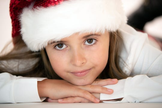 """Naples fourth-grader Kylie Gust, 10, secured her name on Santa's nice list after releasing a Christmas album """"A Kylie Christmas"""" to support national charities like The Humane Society."""