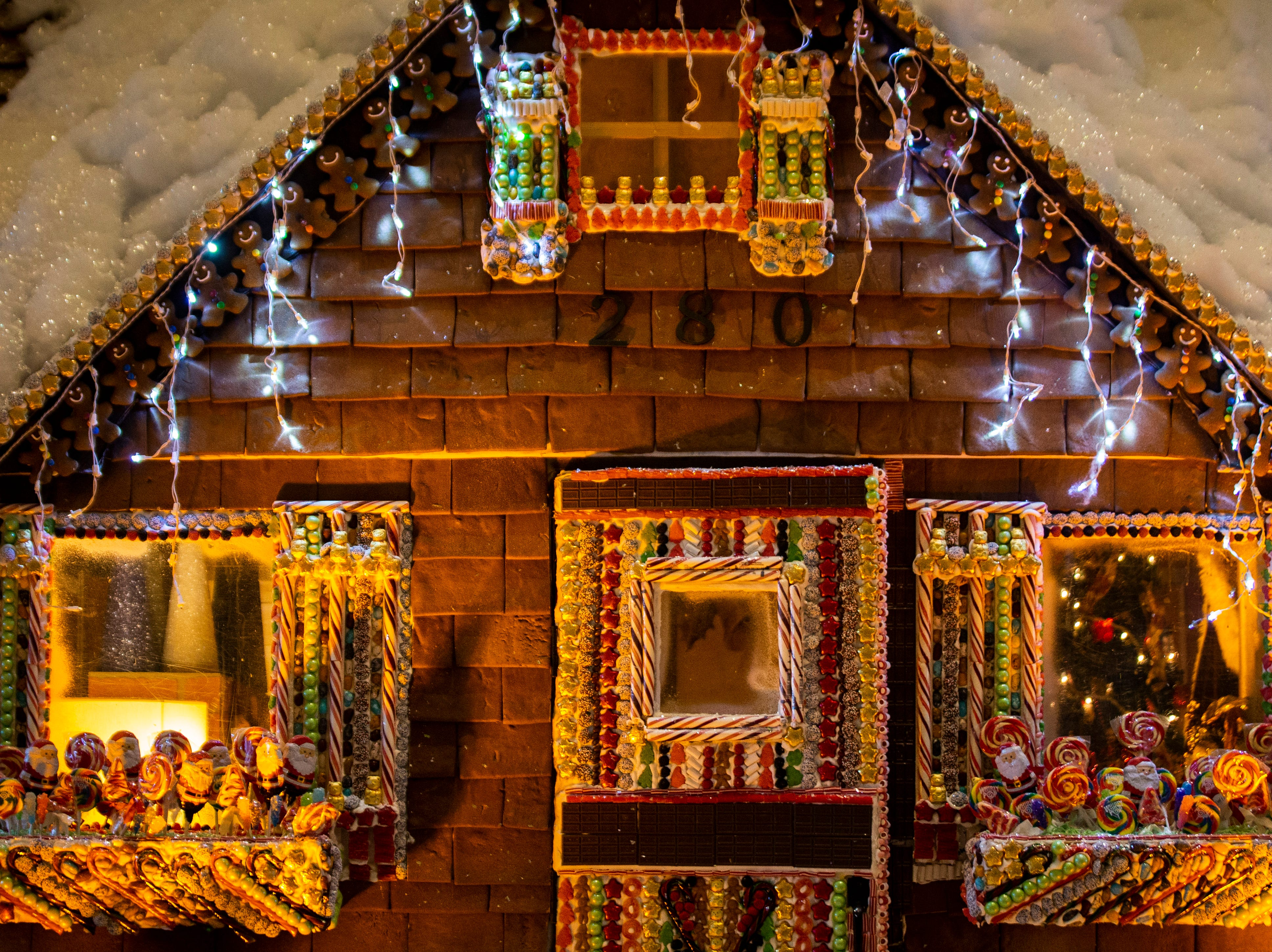 "Pastry Chef Lerome Campbell's life-size gingerbread house sits in the lobby on Wednesday, November 28, 2018, at the Ritz-Carlton in Naples. Campbell is a contestant on Food Network's ""Holiday Baking Championship,"" which airs on Monday nights."