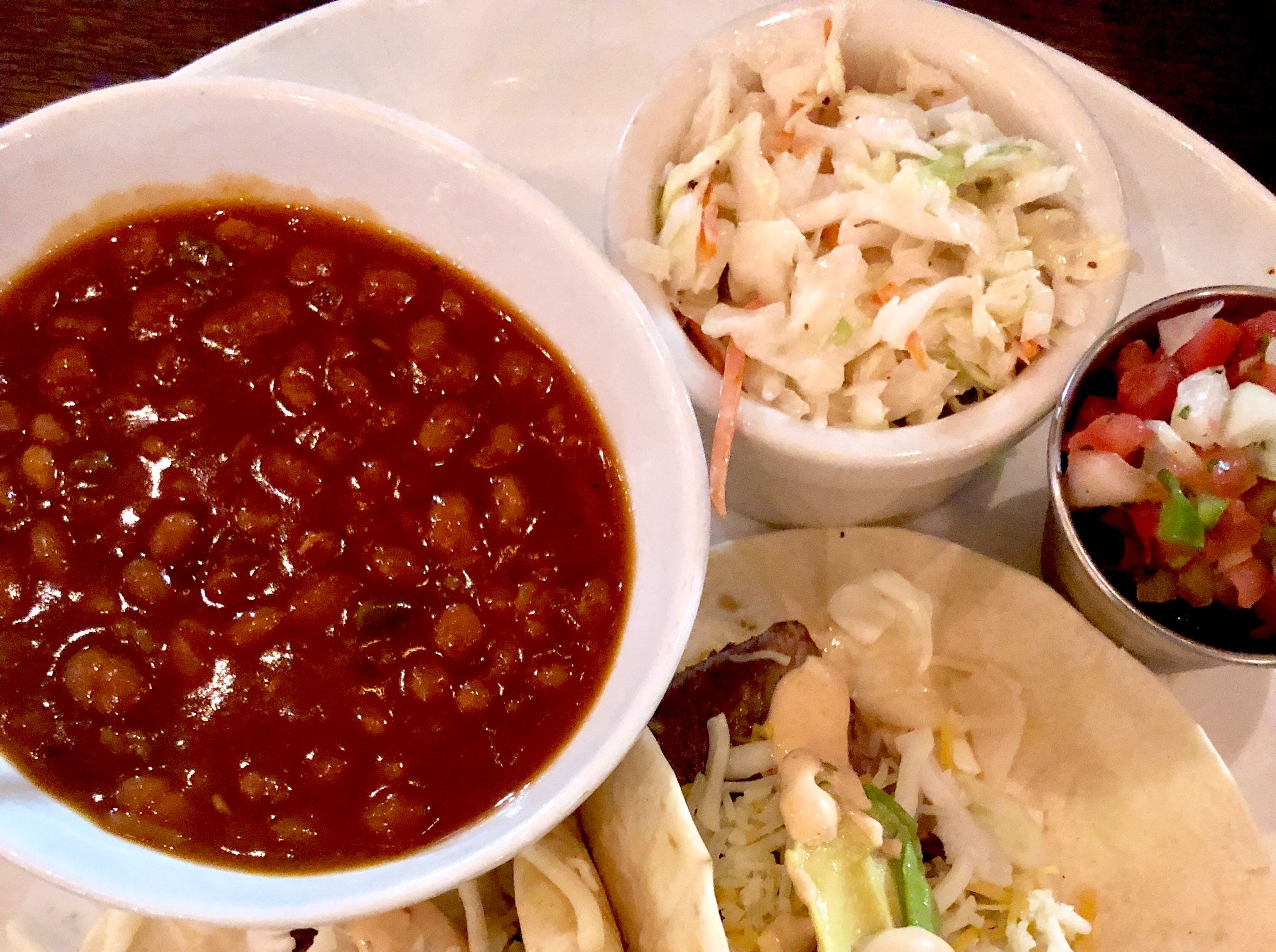 Steak tacos with a side of baked beans and coleslaw at Bone Hook Brewing Co. in North Naples.