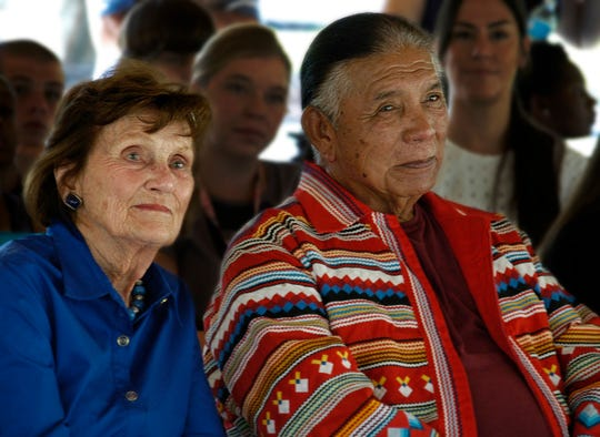 Lavern Norris Gaynor sits with O.B. Osceola Sr. at the dedication of a new chickee hut built in her honor by Osceloa's company to replace one destroyed in Hurricane Wilma in 2005. The ceremony took place on Thursday, June 26, 2014, at the Youth Haven campus in East Naples.