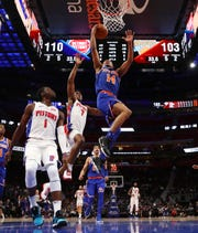 Detroit Pistons forward Stanley Johnson (7) jumps to block the layup by New York Knicks guard Allonzo Trier (14) during the second half of a game Tuesday, Nov. 27, 2018, in Detroit. Trier led all Knicks with 24 points, 10 rebounds and seven assists for his first career double-double.