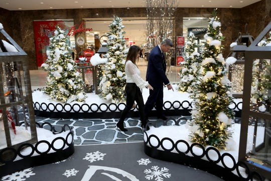 Even the Santa display gets inspected during the morning mall walk. Here Manager Jay Daly and Senior Director of Marketing Lisa Herrmann check the walkway in the Santa court at the mall.