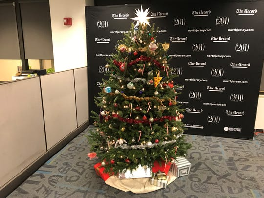 The newsroom's Amazon tree, fully decorated and lit.