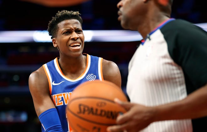 New York Knicks guard Frank Ntilikina argues a call with referee Leroy Richardson during the first half of the team's NBA basketball game against the Detroit Pistons, Tuesday, Nov. 27, 2018, in Detroit.