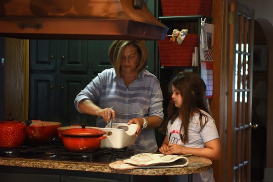 Bella talks with her grandmother, Madeline Caminiti, while dinner is prepared.