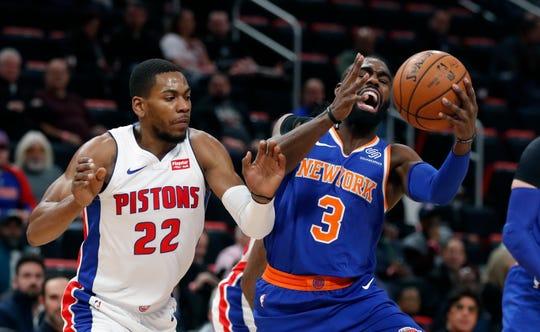 New York Knicks guard Tim Hardaway Jr. (3) grabs a rebound next to Detroit Pistons guard Glenn Robinson III (22) during the first half of an NBA basketball game Tuesday, Nov. 27, 2018, in Detroit.