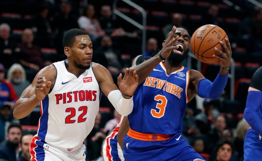 New York Knicks guard Tim Hardaway Jr. (3) grabs a rebound next to Detroit Pistons guard Glenn Robinson III (22) during the first half of an NBA basketball game Tuesday, Nov. 27, 2018, in Detroit.