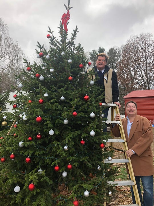 Bill Jerlinski and Derek Eisenberg decorate Maywood's evergreen tree at Van Saun County Park's Winter Wonderland.