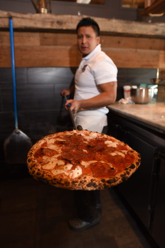 The hot pizza coming out of the oven at S. Egidio in Ridgewood