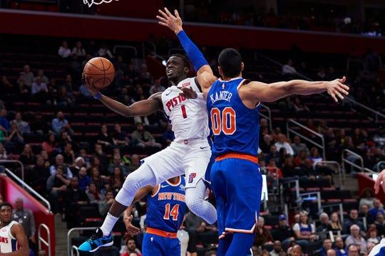 Nov 27, 2018; Detroit, MI, USA; Detroit Pistons guard Reggie Jackson (1) shoots on New York Knicks center Enes Kanter (00) in the first half at Little Caesars Arena.